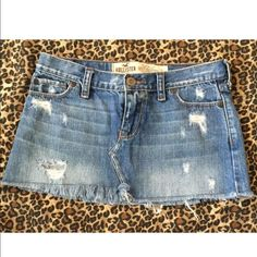 Women's/juniors Hollister destroyed jean skirt Excellent new like condition! This is super stylish!!! A women's/juniors mini factory distressed/destroyed Jean skirt! Made by Hollister this is a medium wash with a factory washed worn look. Is low rise, has neat cut to it and designer pockets and has areas of fray, hole designs and worn look. This is factory frayed at the bottom as well. Total length of the Jean skirt measures approx. 11 in. Super stylish! Women's/juniors Hollister size 1…