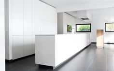 Clean and minimal custom made kitchen. Project 13 by Belgian company WILFRA.