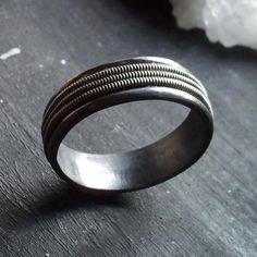 """So cool! Would make a great wedding band for Wade, your """"rocker"""" husband-to-be!  Sterling silver and guitar string band. The Tritone Ring"""