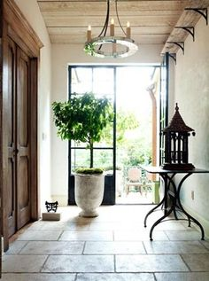 Large scale outdoor urns.  Check our Restoration Hrdw. outdoor sections, simple fixture