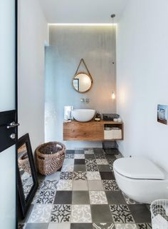"This beautiful industrial chic home in Tel Aviv, Israel, was planned for a family of four. Architect studio NeumanHayner designed two cubes separated by a passage, creating an ""L"" shaped house. The fr Bad Inspiration, Bathroom Inspiration, Interior Inspiration, Bathroom Ideas, Industrial House, Modern Industrial, Vintage Industrial, Industrial Lamps, Industrial Furniture"