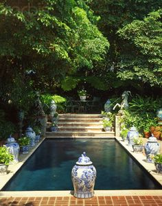 Shady dark plaster garden pool with blue and white planters. Blue and White on the patio. Outdoor Rooms, Outdoor Gardens, Outdoor Living, Outdoor Decor, Beautiful Pools, Beautiful Gardens, Simply Beautiful, White Planters, Villa