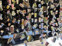 "Gwyeneth Leech: ""Hypergraphia"" installation in the Flatiron building prow art space. (New York.) Many coffee cups with hand-drawn designs."