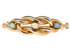 Edwardian 9ct Gold Knot Bracelet Set With Three Opals - buy for £1,275 on The Antique Jewellery Company A well designed lover's knot 9ct gold bangle that was made circa 1910. It is set with three oval matched vibrant opals. The use of opals in antique jewellery signified protection, loyalty and faithfulness. So this symbol together with the lover's knot motif sent a powerful message to the receiver. The centre opal matches the other too but the photograph does not show this well Edwardian Jewelry, Antique Jewelry, Free Ring, Jewelry Companies, Gold Bangles, Bracelet Set, Knots, Heart Ring, Opals