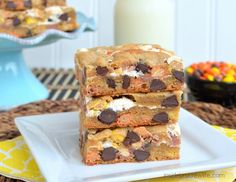 Marshmallow Reeses Blonde Brownies - peanut butter blonde brownies stuffed with marshmallow cream and Reese's Pieces candies