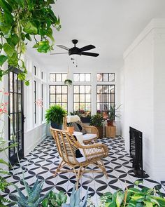 This indoor-outdoor sunroom's high-contrast tile floor picks up on the dark door, window and fireplace perfectly. Porch Tile, Patio Tiles, Porch Flooring, Outdoor Flooring, Outdoor Tiles Patio, Indoor Outdoor, Cabana, Conservatory Flooring, Conservatory Extension