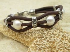 Pearls, artisan silver and chocolate leather bracelet from Tangra2009 on Etsy $79 #jewelry #style #fashion
