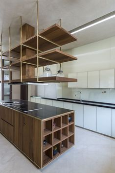Image 1 of 42 from gallery of The House Of Secret Gardens / Spasm Design. Photograph by Umang Shah Ahmedabad, Minimal Kitchen Design, Minimalist Kitchen, Japanese Interior, Contemporary Interior, Interior Decorating Styles, Home Interior Design, Decorating Hacks, Futuristisches Design