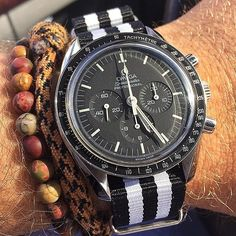 speedytuesday NATO strap from us on the Omega Speedy of @hoytarcher10... NATO black white stripes thewatchobsession omegawatch omegawatches omegaholics omegaspeedmaster omegamoonwatch moonwatch speedmasterprofessional affordableluxury luxury timepiece watchstrap