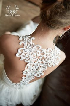Loving the lace racer back on this beautiful bridal gown