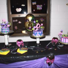 Nieces 16th Mardi Gras themed badly party. Cake table. I got to place the hand made sugar mask, stars and curly q decorations on the cake. Fun  But was a learning exp too!