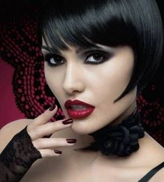Louise Brooks style bob. Sharper angle than traditionally worn. Very edgy and cool.