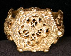 Ring  Object Name: Ring Date: 12th–13th century Geography: Iraq Medium: Gold; cast, chased Classification: Jewelry Credit Line: Gift of Alastair Bradley Martin, 1948