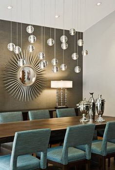 Instead of using chandeliers over a rectangular dining room table, try using multiple pendants to create the feel of a large chandelier.