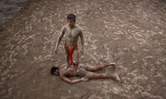 """Wrestlers exercise in mud at a traditional Pakistani wrestling training center called """"Akhaara"""" in the old city of Lahore, Pakistan April 24, 2012.  REUTERS/Mohsin Raza"""