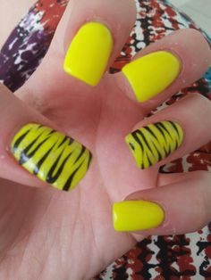 Yellow nails with zebra design