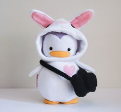 Penguin in a bunny costume?!  If only it had a laptop instead of a camera...  penguins + tuzi + dev = <3