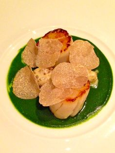 3 star Michelin restaurant, Epicure, at Hotel Le Bristol. Scallops: ratte potatoes gnocchi with white truffle from Alba, watercress juice with brown butter.