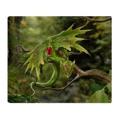 Ruby Birthstone Leaf Dragon Throw Blanket on CafePress.com
