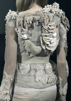 Amazing fabric textures & embelishment - fabulous fashion details. This image reminds me of objects of flotsam and jetsam which I found along Dungeness beach.