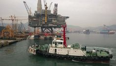 Heerema barge H-851 loaded with Arkutun Dagi platform in Okpo/ Korea