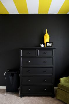 Black Accent Wall in the Nursery pairs well with Yellow Striped Ceiling!