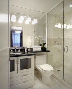 Bathroom By LUX Design With White Cabinets And Tile, A Glass Shower, And A