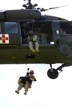 These photos of our MWD heroes are just incredible! Staff Sgt. Carlos Paniagua, Patrol and Explosives Detection Dog Handler, 95th Military Police Battalion, K9 Detachment NCOIC, and his dog, Rex, sit on a Blackhawk's hoist as they get raised up into the Blackhawk during a K9 MEDEVAC training held at Camp Bondsteel, Kosovo. (U.S. Army photo by Spc. Darriel Swatts, 69th Public Affairs Detachment.)