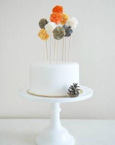 Pom Pom Cake Toppers. cute!
