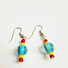 Check out this item in my Etsy shop https://www.etsy.com/listing/242631186/blue-red-and-yellow-earrings