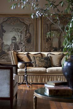 Living Room by Ebanista from Collection Ten - Milano II Sofa, Windsor Side Table, Capriccio I & II Oil Paintings  That sofa