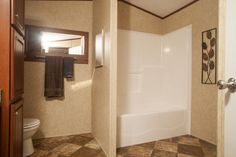Colony Homes - DD106A - Beacon - Bathroom featuring a tub/shower combination, a private commode area, storage cabinet, and a nice sized vanity!