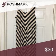Striped dress Black and cream colored striped dress. Approximately 48 inches in length from should to bottom. In great condition. Only worn once. Angie Dresses Midi