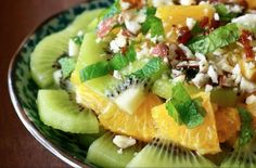 Recipe and Photo Courtesy of Season With Spice Ingredients for salad  2 oranges – peeled and cut into chunks  3 kiwis – peeled and cut into chunks  A handful of toasted almonds - chopped  2 tablespoons fresh mint leaves - chopped finely Ingredients for honey-ginger dressing  1 tablespoon honey  1 1/…