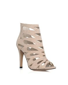 The Natasha - The teardrop cut-out detailing on these open toe heels lends feminine flair to a bold caged style.