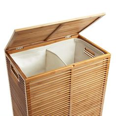 Our Zen Bamboo Laundry Hamper is a stunning solution for containing laundry.  It's so well-designed, you won't want to hide it away in a closet.  Instead, proudly show off the slatted bamboo design in your master bath, bedroom or laundry room.  It has a covered hinged lid and a divided interior liner.