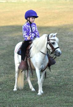 Little girl and her pony at the Trigg County Riding Club Horse Show, Kentucky,  August 7, 2012.