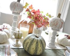 Thanksgiving tablescape.  I totally need to paint my chunky wood candlesticks white.