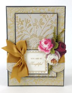 This handmade card's tone-on-tone embossed look was achieved by inking different sides of the Anna Griffin Wildflower Gate embossing folder. Add this garden of designs to your embossing folder collection today: http://shop.annagriffin.com/paper-crafts/embossing-diecutting/cuttlebug-a7-wildflower-embossing-folder.html#.UyB4kEbeARI