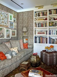 Lisa Fine Textiles' Malula is on the walls and sofa, and Baroda II is on the ottoman.