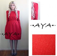A red knee-length dress by AYACLOTHES for $59.00