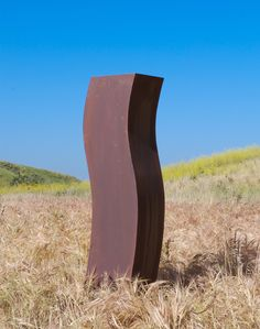contemporary curved weathered steel sculpture for outdoor display