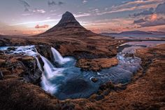 Majestic Kirkjufell Mountain and Kirkjufellsfoss falls in Iceland.