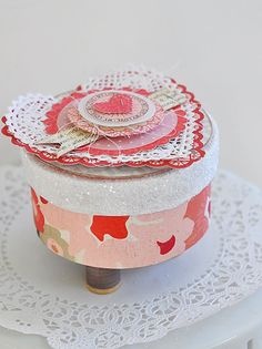 Valentine made with layered doilies and paper embellishments