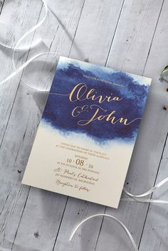 Stunning watercoloured invitation with golden calligraphic font