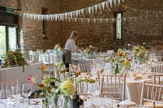 Colourful country garden flowers in a mix of antique & contemporary bottles make great centre pieces at all the Somerset & Cotswold Stone Barns. Here's a recent design at Priston Mill by top Bristol Wedding Florists, The Wilde Bunch. So natural & pretty. Rehearsal Dinner Decorations, Rehearsal Dinners, Wedding Decorations, Table Decorations, Wedding Events, Our Wedding, Weddings, Stone Barns, Centre Pieces