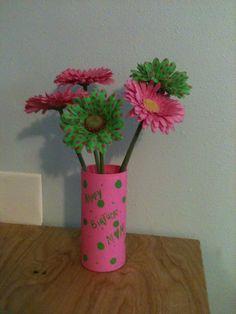 Dollar store vase ($1), martha stewart paint (on hand), flowers from Michaels ($1/each).  $6