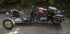 trike in front, motorcycle in back