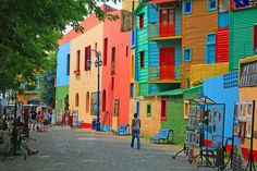 The multicolor homes that line the La Boca neighborhood of Buenos Aires, Argentina, still reflect much of their late-19th-century history. When European immigrants arrived from the Italian city of Genoa, many of them became dockworkers, who, with little to no disposable income, built their homes with thin pieces of corrugated sheet metal from the docks, coated with leftover paint. When one color inevitably ran out, they would simply use another one. And thus a colorful neighborhood was born…