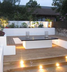 Stunning outdoor entertaining area featuring beautiful garden and deck lighting.